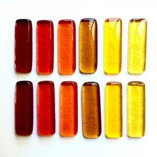 Coffret de 12 porte-couteaux rouge-orange-ambre-jaune